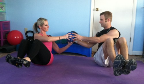 SIDE OBLIQUESSit with your partner beside you a little less than arms length away. Bend your knees and lean back to a 45 degree angle. Lift your feet off the floor if possible. If that is too hard, keep your feet on the floor. Holding a medicine ball, twist to your partner and hand them the medicine ball. You and your partner will both twist to the oppostite side. As you twist to the other side, your partner will hand you the ball. Keep twisting and handing each other the ball for the prescribed number of reps.If you do not have a partner: Just do oblique twists, holding the medicine ball and twisting from side to side.