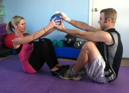 MEDICINE BALL CURLUPS<br /><br /> Sit facing your partner, knees bent, feet on the floor. One person can have their feet on top of their partner's feet.  Both members lie back and keep your arms stretched behind your head. Keeping your arms straight, curl up and hand  the ball to your partner. Keep doing curl ups and handing the medicine ball off to each other for the prescribed number of reps.<br /><br /> If you do not have a partner: Do curlups with a medcine ball. Instead of handing the ball to a partner, reach the ball in the air.