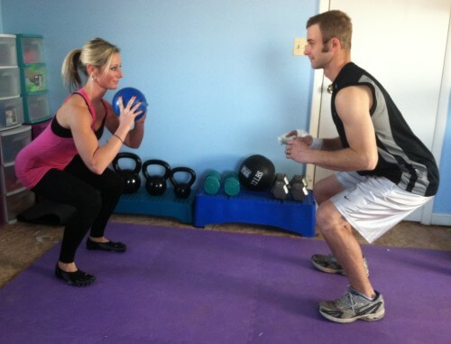 SQUAT THROWS WITH MEDICINE BALLGrab a medicine ball and stand facing your partner, about 6 feet away from each other. The person with the medicine ball squats down. Keep your back straight, legs parallel to the ground, and chest up. As the person with the medicine ball is coming up from the squat, toss the medicine ball in the air to the other person. The other partner catches the medicine ball and squats down. Keep squatting and tossing it back and forth for the prescribed reps.If you do not have a partner, throw the medicine ball up in the air. As you catch it, squat down.