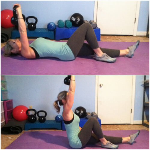 HALF GET UPLIe on your back with your kettlebell in your right hand, arm stretched up towards the ceiling. Bend your right knee. Leave your arm stretched toward the ceiling throughout the entire move. Brace your core using your left arm to press up, curl your upper body up. Lower back down and repeat for the prescribed reps. This is a difficult move, so if it's too hard, ditch the weight. If it's still too hard, grab your right hamstring with your right hand to help you curl up.
