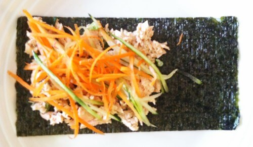 STEP TWO: Place your julienned carrot and cucumber on top of the salmon salad.