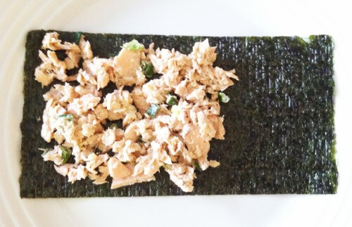 STEP ONE: Place 2 to 3 spoonfuls of salmon salad over 2/3 of the seaweed paper.