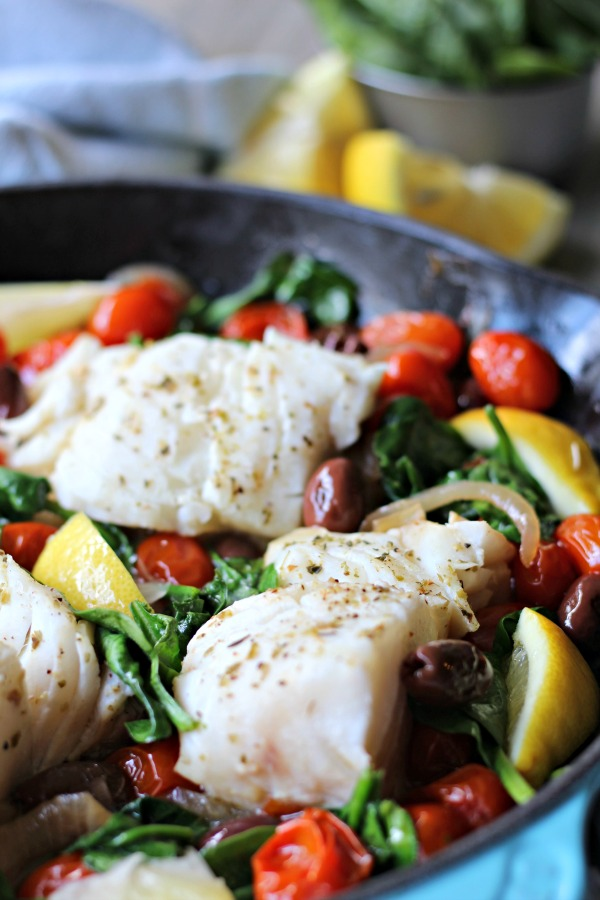 This Easy Greek Fish Skillet recipe has restaurant worthy flavor yet is simple enough to make on a busy weeknight! It's a one pan, healthy meal that's Paleo, Whole30 and Gluten Free.
